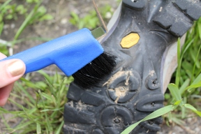 Hard-soled boots are easy to clean, scrub brushes, sponges and even horse hoof picks are all great at getting mud out of treads.