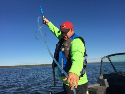 Gilmen Cardinal Bigstone Cree Nation conducting lake water sampling